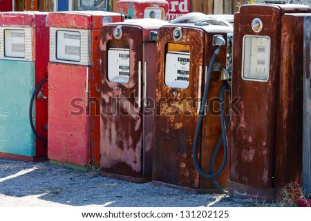 Old rusty gas pumps - stock photo
