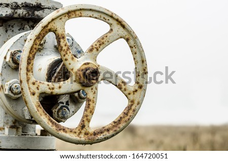 old rusty gas valve - stock photo