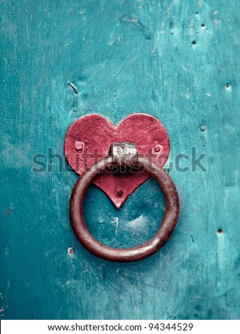 Old rusty gate latch on the door - stock photo