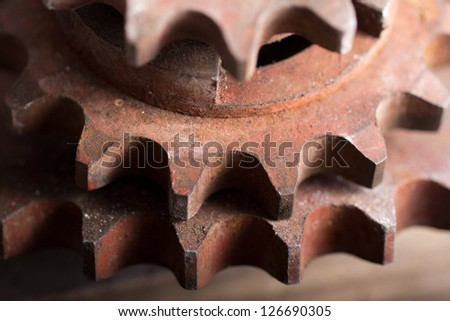 Old rusty gears, machinery parts - stock photo