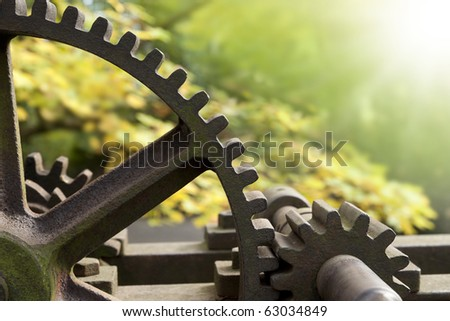 Old rusty gears, transmission wheels - stock photo