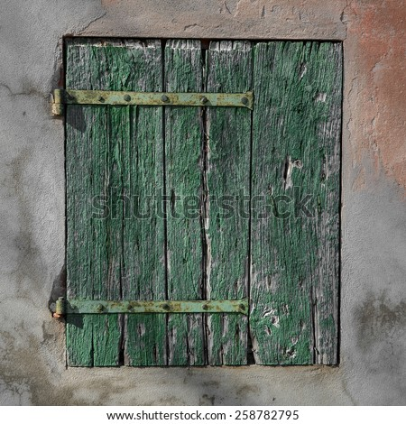 old rusty green wood shutter - stock photo
