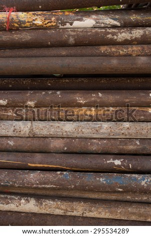 old rusty grungy metal or steel rods or bars in construction structure - stock photo