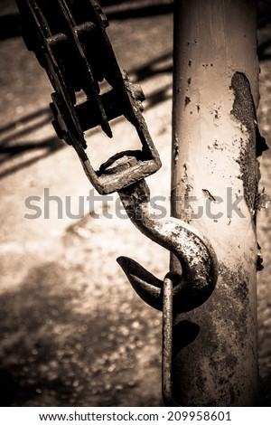old rusty hook in the harbor