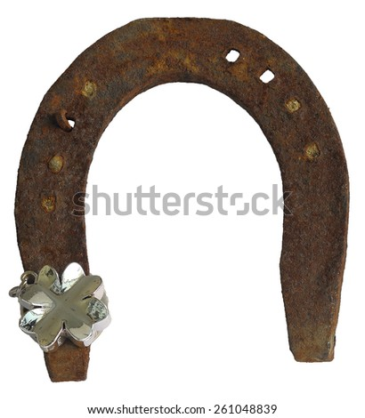 old rusty horse shoe isolated over white background and four leaf clover silver - stock photo
