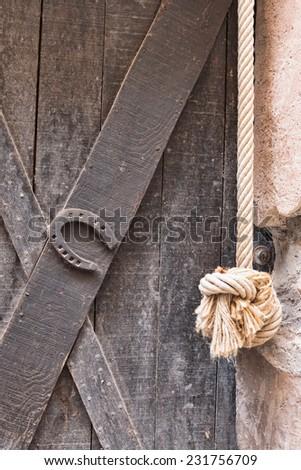 old rusty horseshoe on a door - stock photo