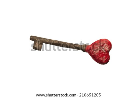 Old rusty iron key with love heart shape part  - stock photo