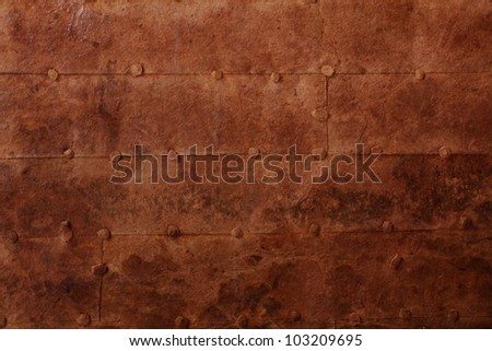 old rusty iron surface with rivets - stock photo