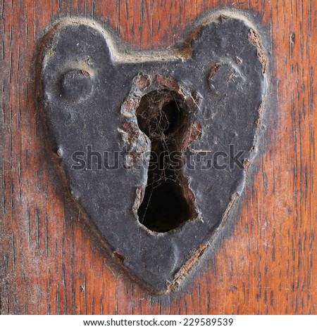 old rusty key hole - stock photo