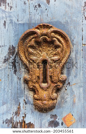 Old rusty keyhole - stock photo