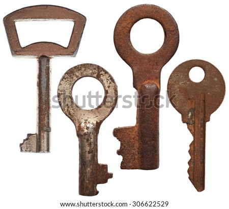 Old rusty keys isolated on white background - stock photo