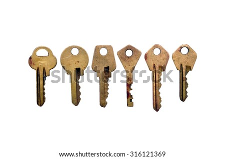 Old rusty keys isolated on white background. A bunch of keys - stock photo