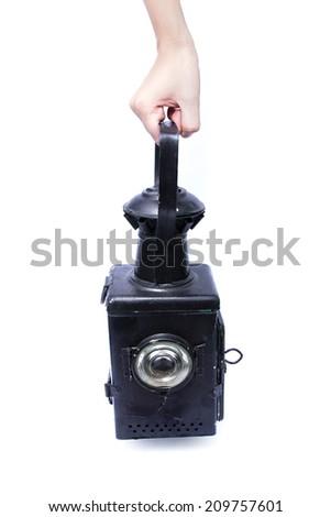 Old rusty lantern over white - stock photo