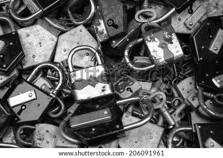 Old rusty locks and keys at flea market in Paris. Aged photo. Black and white. - stock photo