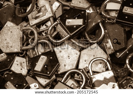 Old rusty locks and keys at flea market in Paris. Aged photo. Sepia. - stock photo