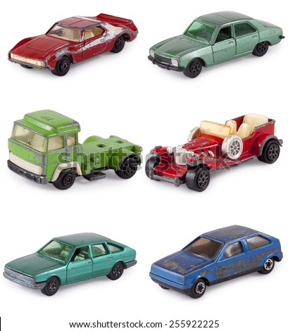 Old rusty metal car toy - stock photo