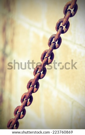 Old rusty metal chain. Vintage composition - stock photo