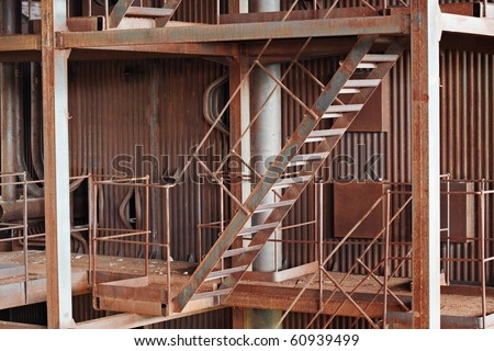 Old rusty metal construction - an abandoned boiler room - stock photo