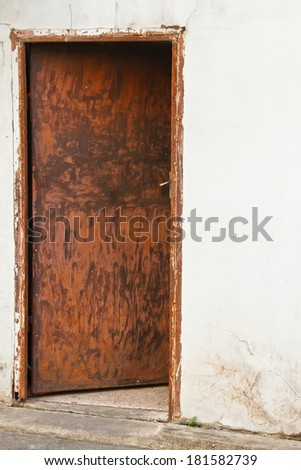 Old rusty metal door - stock photo