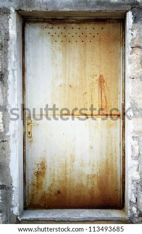 Old rusty metal door, Croatia - stock photo