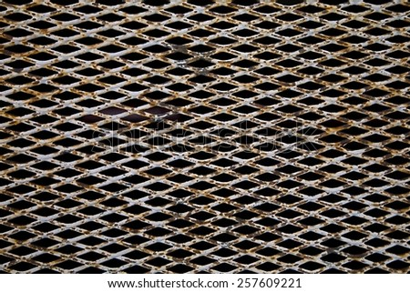 Old rusty metal grid pattern - stock photo