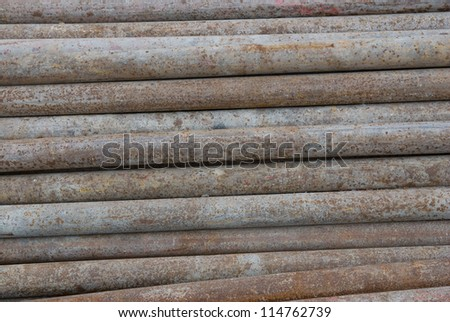 Old rusty metal pipes - stock photo