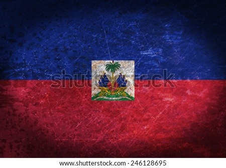 Old rusty metal sign with a flag - Haiti