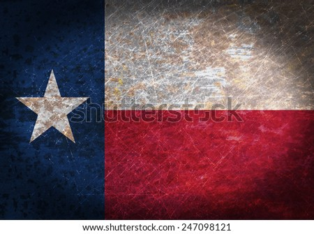 Old rusty metal sign with a flag - Texas - stock photo