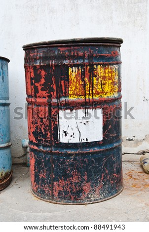 Old rusty oil drum with white sticker - stock photo