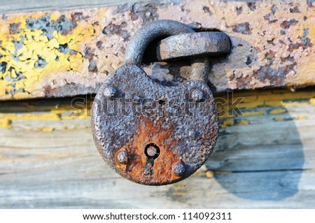 Old rusty padlock - stock photo