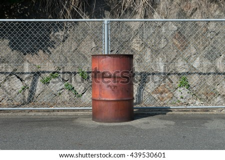 old rusty painted barrels outdoors - stock photo