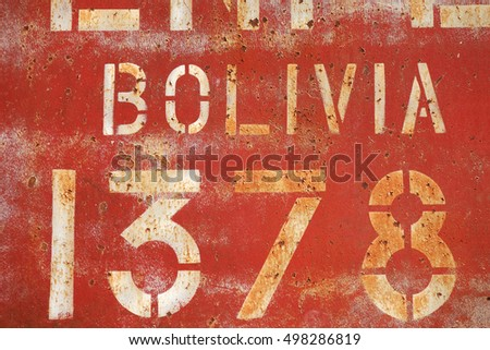 old rusty painted metal wall with inscriptions, wallpaper background