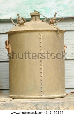 Old rusty pressure cooker in warehouse. - stock photo