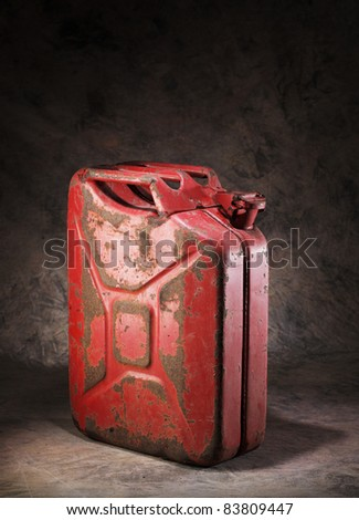 Old rusty red metallic jerry can. - stock photo