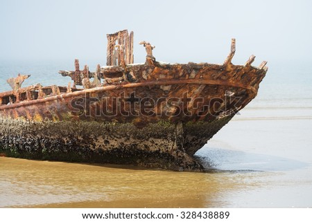 Old rusty shipwreck on a foggy morning on the Skeleton Coast, Namibia