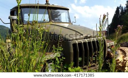 Old rusty soviet truck. Vintage truck. Abandoned truck. - stock photo