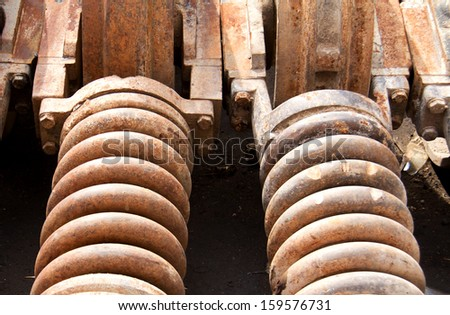 Old rusty spring - stock photo