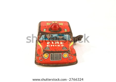 Old, rusty tin toy. Firefighter car. - stock photo