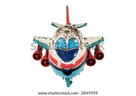 Old, rusty tin toy. Jumbo Jet. - stock photo