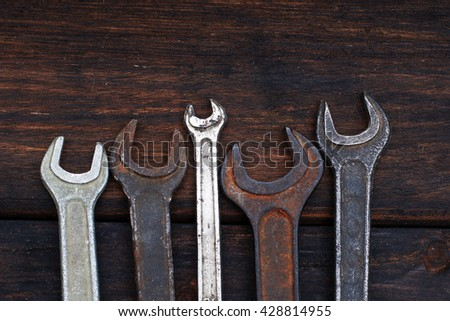 Old, rusty tools lying on a wooden table. Hammer, chisel, metal scissors, wrench, chisel. old tools on wooden background . Dirty set of hand tools on a wooden panel/vintage background with a tools - stock photo