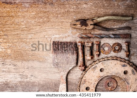 Old rusty tools on old wood background. vintage photo - stock photo