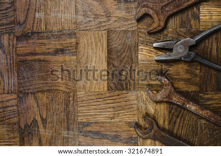 old rusty tools on wooden background - stock photo