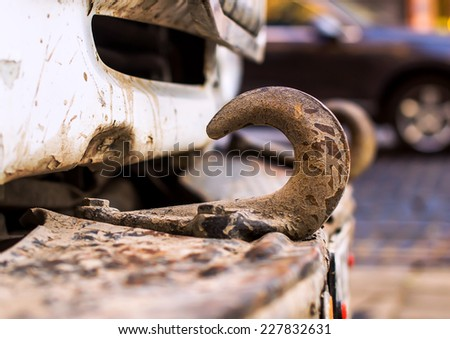 Old rusty tow hook - stock photo