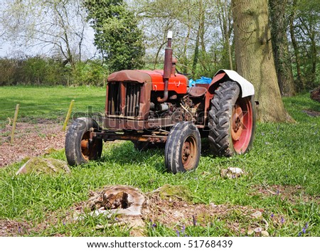 Old Rusty Tractor in an English Woodland Glade in Spring