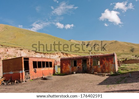 Old rusty trailers of coal mining workers in the mountains - stock photo