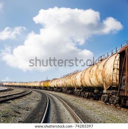old rusty train wagons on railway - stock photo