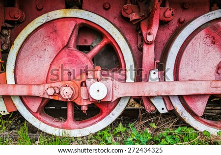 Old rusty train wheels, detail of old locomotive. - stock photo