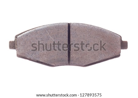 Old rusty used car brake pads on a white background. - stock photo