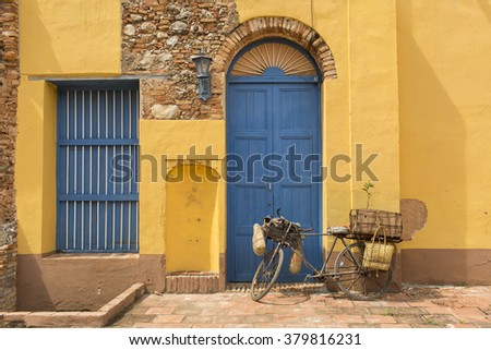Old rusty vintage bicycle near the concrete wall - stock photo