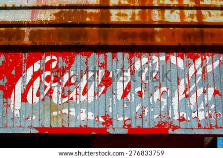 Old, rusty  vintage logo of Coca Cola . on may 08, 2015 in Plovdiv,Bulgaria